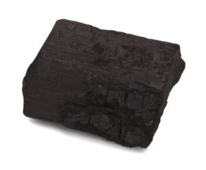 Wooden coal piece on the white background